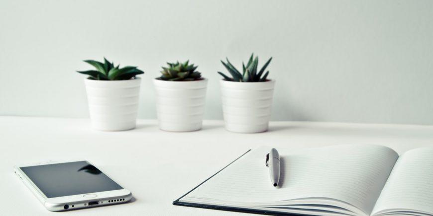 white desk, phone, pen